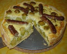 "Bratwurst and brussels sprouts quiche - It started out as brussels sprouts quiche but then someone said: ""I know how we can make this even better!"" // (My OCD is having fits right now. If you're going to arrange wieners on top of a quiche, at least make a symmetrical pattern!!)"