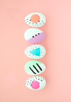 DIY Pastel Memphis Easter Eggs: The key to making them look 80's inspired is to stick with geometric shapes. Try your hand at using squares, circles, and triangles with a combo of crosshatch lines, small confetti lines, and dots.