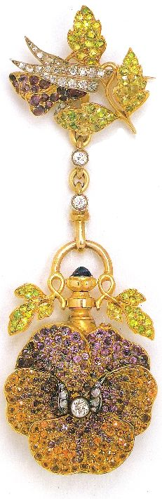 Image Belle Epoque of French Jewellery 1850-1910  Thomas Heneage & Co Limited, London    This Bocheron Pansy watch,1890-95, is silver-gilt, made with sapphires,  demantoid,  spessartine, and hessonite garnets, amethysts and diamonds.