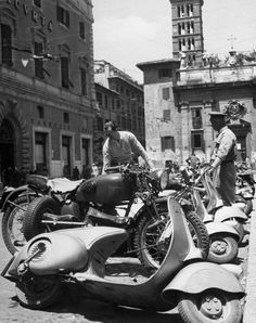 This is a 1948 shot of Piazza San Silvestro, just down the street from us -- and a long line of some very cool scooters!