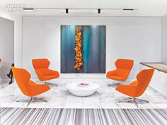 Ginkgo Lounge High Back Chairs from Davis Furniture - Bright Colors and Contemporary Artwork Punctuate Pritzker Group's Los Angeles Headquarters by HOK | Fresh flowers are intended to complete a Cor-Ten steel wall sculpture by Jannis Kounellis. #design #interiordesignmagazine #interiordesign #projects #offices