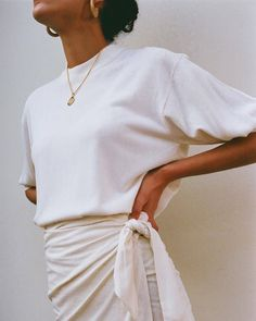 TOTALLY STUNNING, LOVE HER GORGEOUS WHITE WRAP SKIRT, WORN WITH A SIMPLE WHITE TEE! - LOOKS SO BEAUTIFUL!