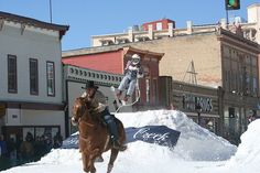 Winter's first big snowfall means getting ready to plow through some powder—on a shovel, behinda horse, or in a kayak.