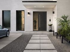 We've put together some of our favorite outdoor pool tile and patio tile ideas to help you get inspired in your own backyard! Modern Entrance Door, House Entrance, Side Yard Landscaping, Modern Landscaping, Design Exterior, Door Design, Design Art, Porch Tile, House Front