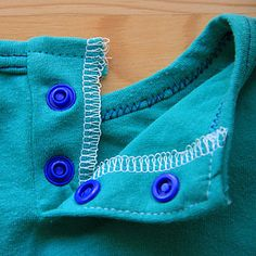 Adding a Neck Opening to a Tee - Tutorial Uses a continuous placket. Useful when neck openings don't fit but the top still does.