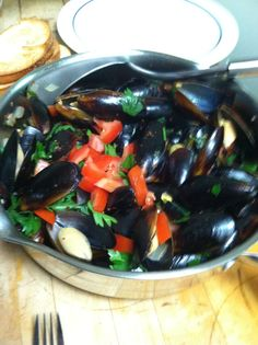 Spicy Mussels- Recipe from Bobby Flay    http://www.foodnetwork.com/recipes/bobby-flay/spicy-mussels-with-white-wine-recipe/index.html