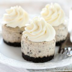An easy two ingredient Oreo crust topped with a smooth and creamy Oreo cheesecake filling. These Mini Oreo Cheesecakes make a perfect dessert!