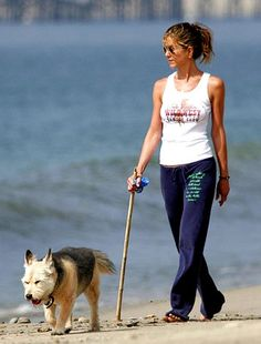 Jennifer Aniston celebrity dog Norman - I truly LOVE that she is carrying a poop