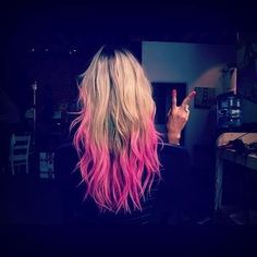 Dark blonde hair and pink dip dye is a perfect look for the summer