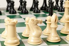 Quadruple Weight Tournament Chess Game Set - Chess Board Game with Natural Chess Pieces, Green Vinyl Board and Chess Strategy Guide * Continue to the product at the image link.