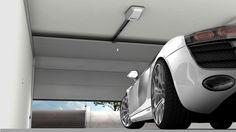 Portone sezionale automatico Tau. Automatic garage door.