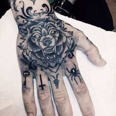 Sick Black And Gray Wolf Hand Tattoo