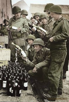 American GIs liberating wine from French civilians after liberating the village.