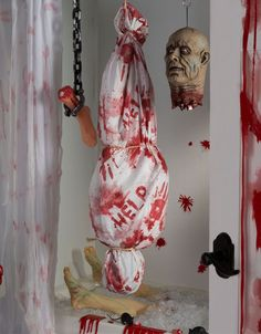 Zombie props for a gruesome and gory zombie party! Find more zombie party ideas at blog.partydelights.co.uk. #halloween