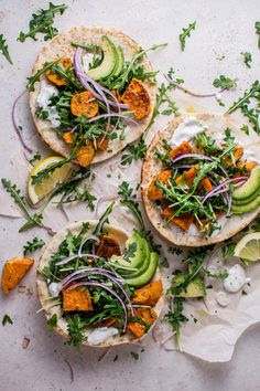 These roasted sweet potato pitas with arugula and garlic dressing are a fresh, healthy, and comforting vegetarian meal. So satisfying that even meat eaters will love them!