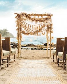 DIY Wedding Arch: Many seaside venues have a bamboo ceremony arch similar to this. One way to elevate it, Polynesian-style, is with DIY garlands made from a sand-friendly staple: grass skirts! (Raffia skirting, $8; save-on-crafts.com. Lauhala mats, $30 each; sunsetbamboo.com.)
