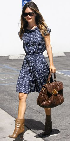 Rachel Bilson shows off her fashion sense in a polka-dot dress from Alexa Chung for Madewell, booties and a Miu Miu bag. Rachel Bilson made a stylish transition to fall by adding cold-weather-ready ankle boots to a flirty summer dress. Her brown quilted bag was the perfect seasonally appropriate finish.