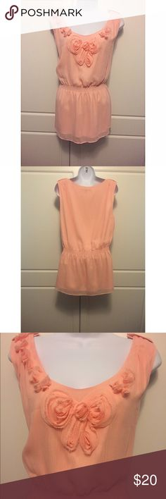 """Gianni Bini Pink Chiffon Sleeveless Top Soft pink, ultra feminine top by Gianni Bini. Epaulets on the shoulders and rosette embellishment add interest. Bloused silhouette with elasticized dropped waist. Fully lined. Measures 20.5"""" at bust and 26.25"""" long. Gianni Bini Tops Blouses"""