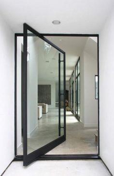 Unusual glass door swivels on middle axis.