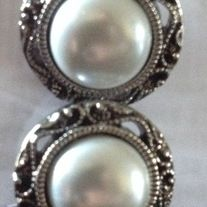 """Beautiful round silver pearl gauges  All plugs are made with black, acrylic, backs and have rubber o-rings. If you would like a custom backing, please message me.   These come in a variety of sizes:  0g 00g 1/2"""" 9/16""""  Please choose when ordering.  All plugs/gauges are sold in pairs."""