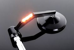 Beautiful and absolutely high-quality handle bar end mirror with integratedLED winker light in the mirror arm. The head is made of black anodizedOf aluminium. Cb500 Cafe Racer, Cafe Racer Honda, Cafe Racer Build, Motorcycle Mirrors, Motorcycle Bike, Cafe Racer Handlebars, Nine T, Beautiful Mirrors, Led Headlights