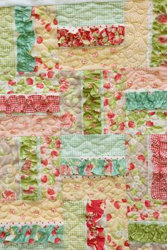 Love the ruffle in this quilt made by ... ~a charitable organiztion of women helping orphans around the world ♥  The PDF pattern is only $5 - you can have it in minutes! It takes a jelly roll (or scraps) and yes those borders are Minky.   Link to pattern: http://createhopedesigns.bigcartel.com/product/a-soft-place-to-land-quilt