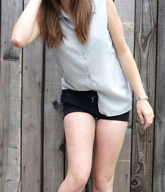 sleeveless shirt with basic black shorts