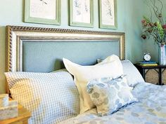 Create a headboard picture frame by using decorative molding from a home improvement store. Screw the molding to a fabric-covered wood panel sized to fit the bed. Or adapt a prefabricated picture frame by screwing it to a fabric-covered plywood panel. Match the frame and the fabric to the bed linens. (Photo: Photo: Thomas J. Story; Designer: Jan Kavale Interior Design)