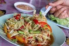 A photo of Som tam thai - Thai cuisine Thai Recipes, Indian Food Recipes, Asian Recipes, Cooking Recipes, Healthy Soup, Healthy Eating, Eat Thai, Authentic Thai Food, Food Concept