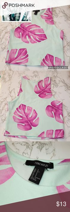 Palm Leaf Crop Top ️Make an Offer️ •This is a super cute crop top tank. Never worn, NWOT. It's a pastel minty aqua color with fushia watercolor palm leaves all over it. It doesn't show my stomach since I'm 5'0, but it could on you if you're taller. Forever 21 Tops Crop Tops