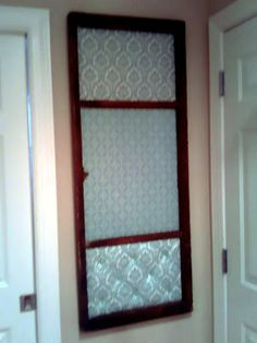 Could do this with a reclaimed glass cabinet door.