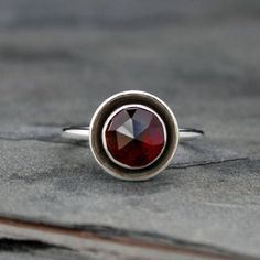 Rose Cut Garnet Halo Ring    Marsala red garnet set in a halo of sterling silver.  Kira Ferrer Jewelry