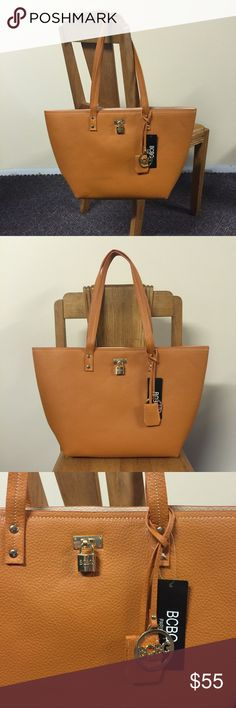 BCBG Paris Tote NWT Brand new, beautiful butterscotch or camel colored tote from BCBG Paris. Gold colored hardware accents. Please ask if you have any questions, need any measurements or more pictures. No trades. BCBG Bags Totes
