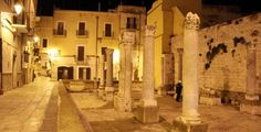 Remains of the Byzantine church of Santa Maria del Buon Consiglio  (St. Mary of the Good Advice) - 9th/11th century CE - Colums and floor mosaics suddently appear as a silent niche out of time in the middle of Bari Vecchia (Bari old town), an intricate maze of narrow streets, old palaces, arches, monumental churches which is a striking world apart amid the current city of Bari, Italy