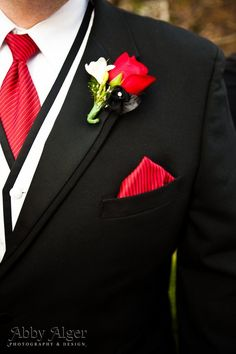 black and red suit with a cheeky little flower bit