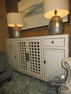 """Solid antique wood lattice front cabinet in a gray-white finish. There two drawers and three shelves inside. Wonderful TV cabinet for a smaller space or even a buffet for a dining room! 62""""L x 17""""D x 36""""H. Beautiful!"""