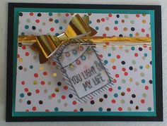 "Stampin' Up! has a new punch available for the bow ""challenged"" stampers (and fun for bow makers, too)! The ""Bow Builder Punch"" is only $16.95 and you can use with your card stock or Designer Series Paper.  Also featured is the ""One Tag Fits All"" stamp set and the ""Note Tag"" punch. All images are Stampin' Up! copywrite. Available online 24 hours a day at www.lizmichealson.stampinup.net class project 1/20/15"