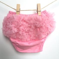 Our pink ruffle bloomers are simply adorable. These ruffled baby bloomers are made of cotton with cute tulle ruffles on the rear. Perfect as diaper covers.  97% Cotton 3% Spandex  Check out more of our baby bloomers here: https://www.etsy.com/ca/shop/RascalsRhinestones?ref=l2-shopheader-name  Please allow 1-2 business days for order to be shipped out.  All of our accessories come professionally packaged with a Rascals & Rhinestones Boutique card and a gift receipt which makes my products…