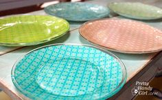 scrapbook paper glued to glass plates