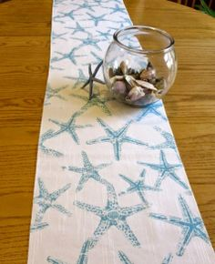 Handmade Coastal Table Runner. Starfish, Coral, and others: http://www.completely-coastal.com/2014/06/handmade-coastal-nautical-table-runners.html
