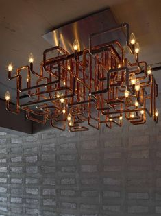 Custom made copper chandelier by noiz architects for an apartment in Taipei. Pipe Lighting, Industrial Lighting, Vintage Lighting, Interior Lighting, Lighting Design, Light Fittings, Light Fixtures, Ceiling Fixtures, Copper Lamps