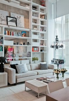high ceilings, beatiful shelving job, stylish yet simple furniture. i love this space