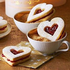 """Lingonberry Hearts: A """"window"""" on the top of these cookies shows off the jam inside, but if you're feeling lazy, just sandwich the preserves between two solid cookies. Filled Cookies, Sweet Cookies, Xmas Cookies, Sugar Cookies, Cookies Et Biscuits, Sweet Treats, Heart Cookies, Linzer Cookies, Baby Cookies"""