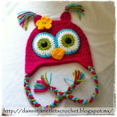 Ravelry: MizzJanet's Owl Beanie  made from this pattern:  http://daisycottagedesigns.net/crochet/free-owl-hat-crochet-pattern/