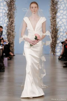 www.oscardelarenta.com, Oscar de la Renta spring 2014 silk mikado draped wedding dress Keywords: #weddings #jevelweddingplanning Follow Us: www.jevelweddingplanning.com  www.facebook.com/jevelweddingplanning/