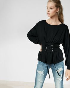 Take on the trends with this sweatshirt that combines a a cool hue with an adjustable lace-up front and peplum hem. It takes laid-back street style to a whole new level of comfort and style.