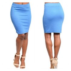 Pretty Blue Skirt  Stretch fit bandage mini skirt in blue. 68% Rayon 32% Polyester. B5. Skirts Mini