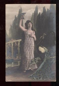 Lady with wine glass and peacock.  Antique happy hour!