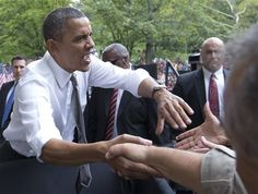#3 9/17/12 President Barack Obama greets people after speaking at a campaign event at Eden Park's Seasongood Pavilion, Monday, Sept. 17, 2012, in Cincinnati, Ohio.  Associated Press