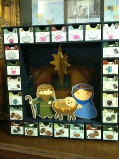 Advent Calendar for School Auction.  Fingerprint Nativity characters.  Each child placed a prayer in their drawer.